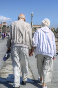 Older Couple Walking on Pier